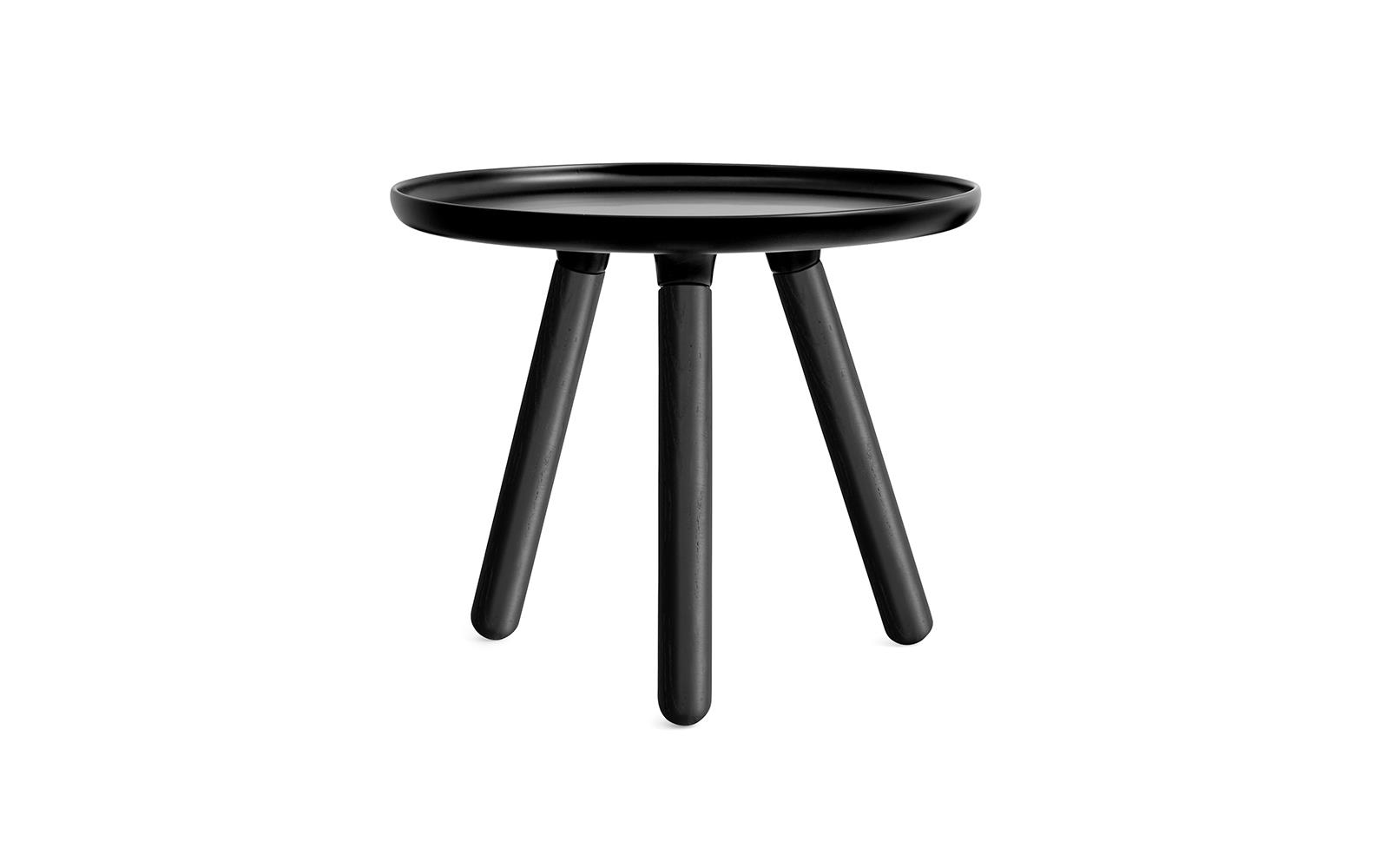 A Minimalistic Coffee Table In Black With