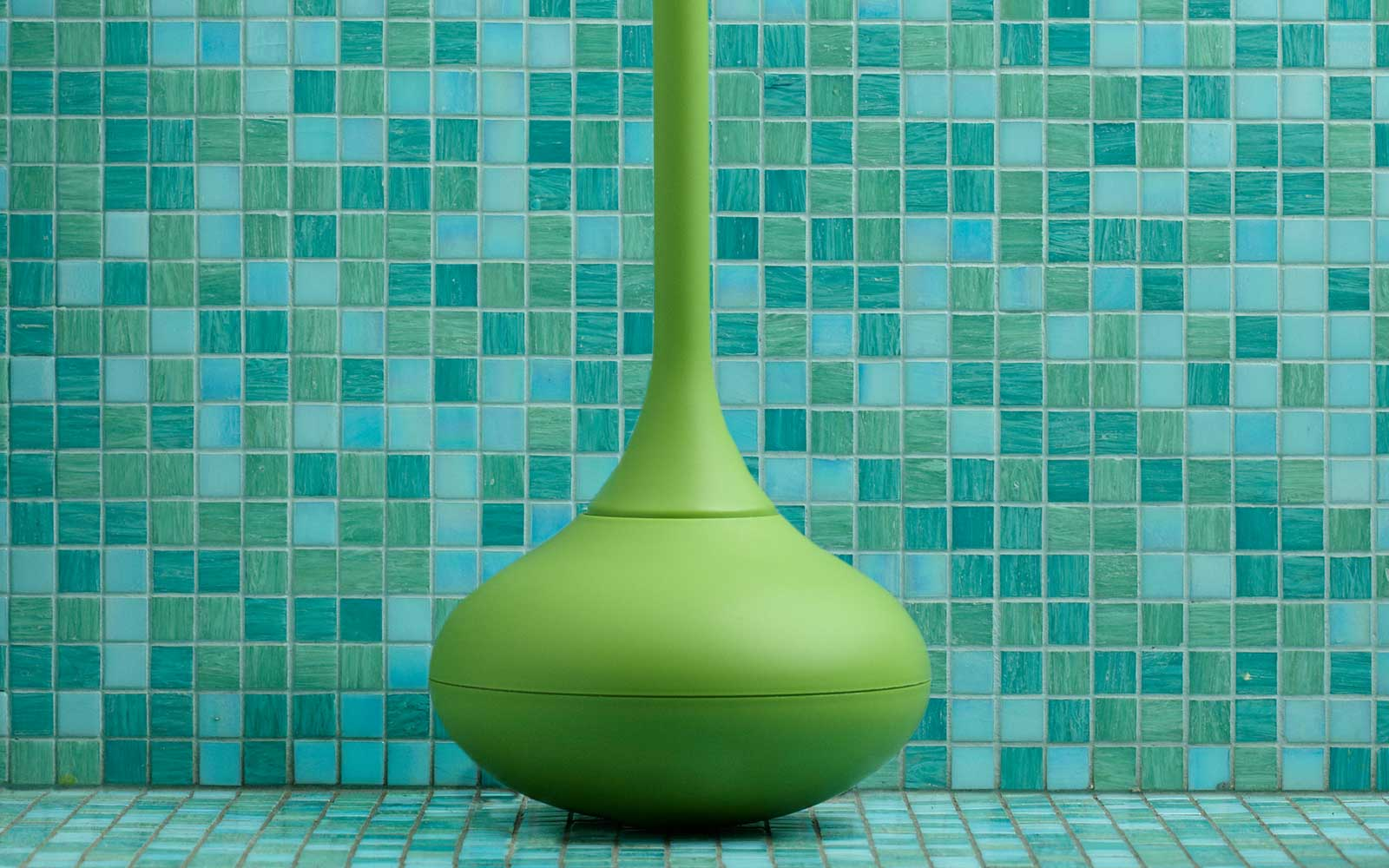 Ballo toilet brush front green mosaic background