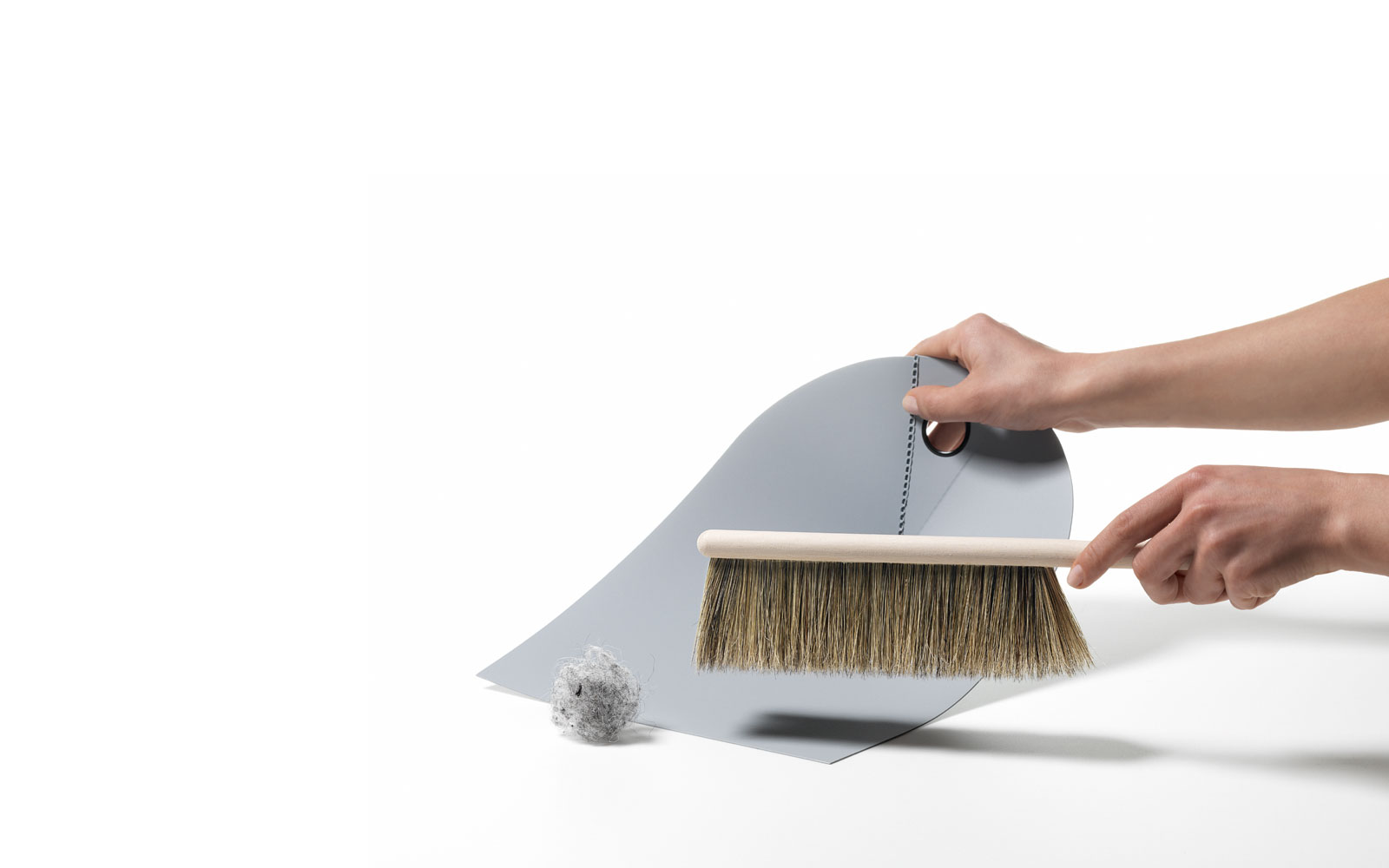 Dustpan lightgrey function action with hand and broom