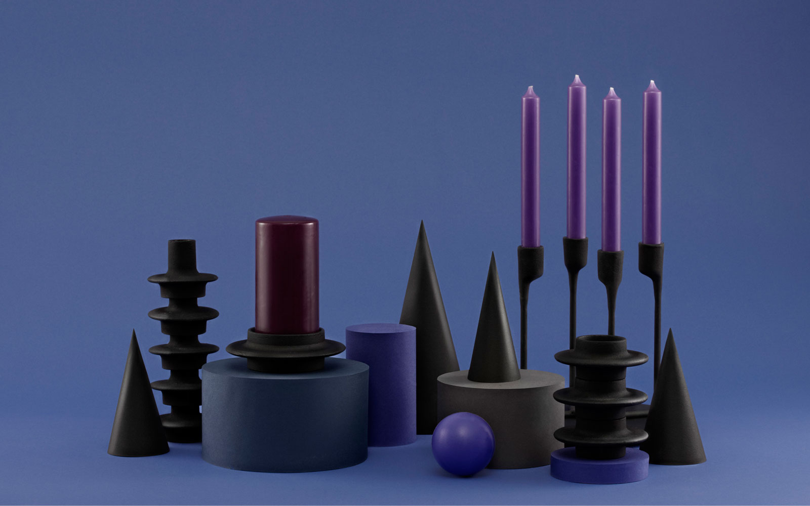 Heima candleholders castiron black familiy function group on blue dark background purple details