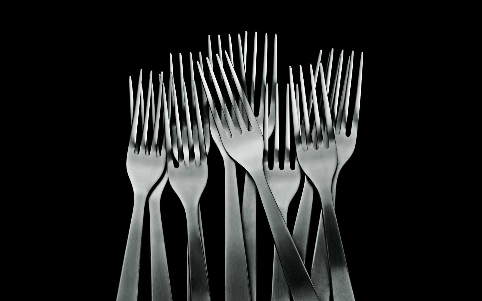 Normann Cutlery group forks on black background