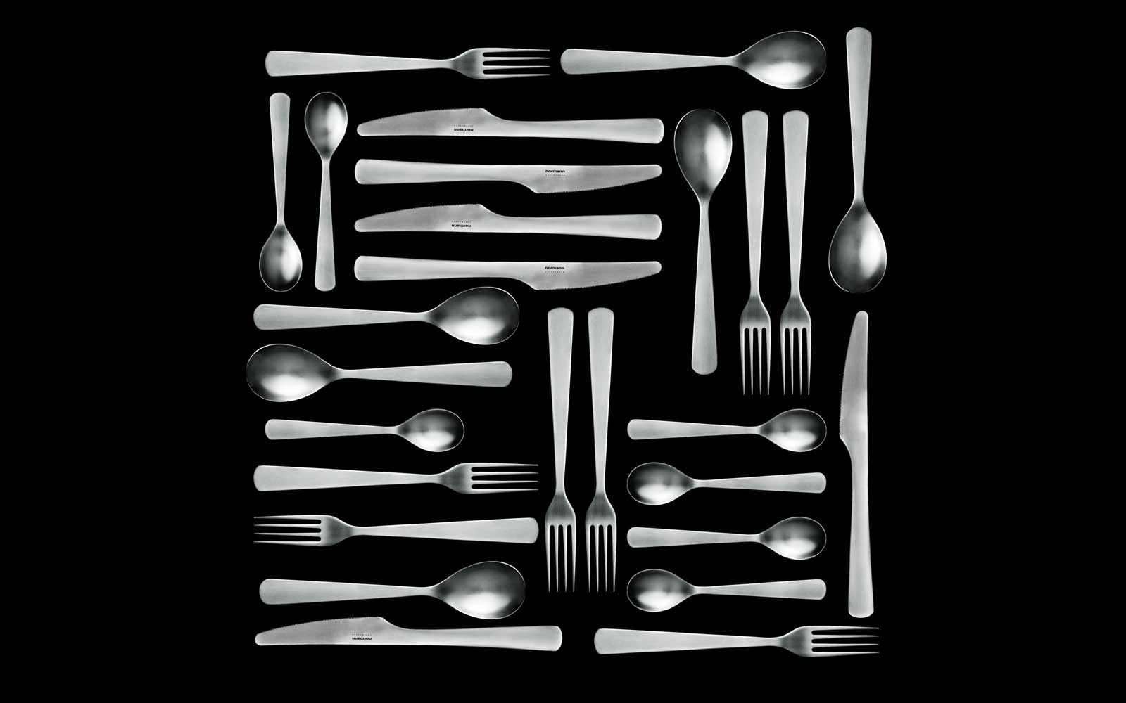 Normann Cutlery all pieces pattern on black background