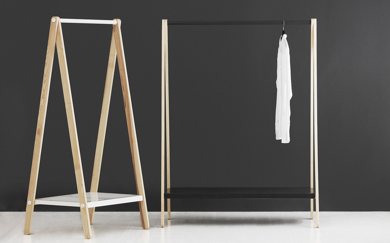 Toj is a clothes rack with an industrial and simple expression. Its function is evident and its simple construction – with a rail, shelf and trusses – provides space for clothes, shoes and bags.