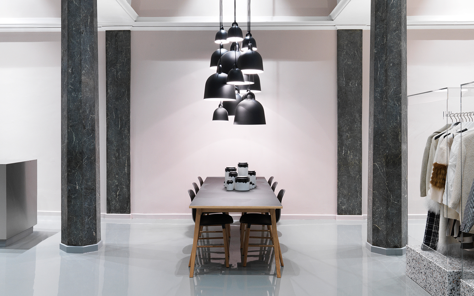 Bell lamps in various sizes hovering above the slice table - Normann copenhagen paris ...