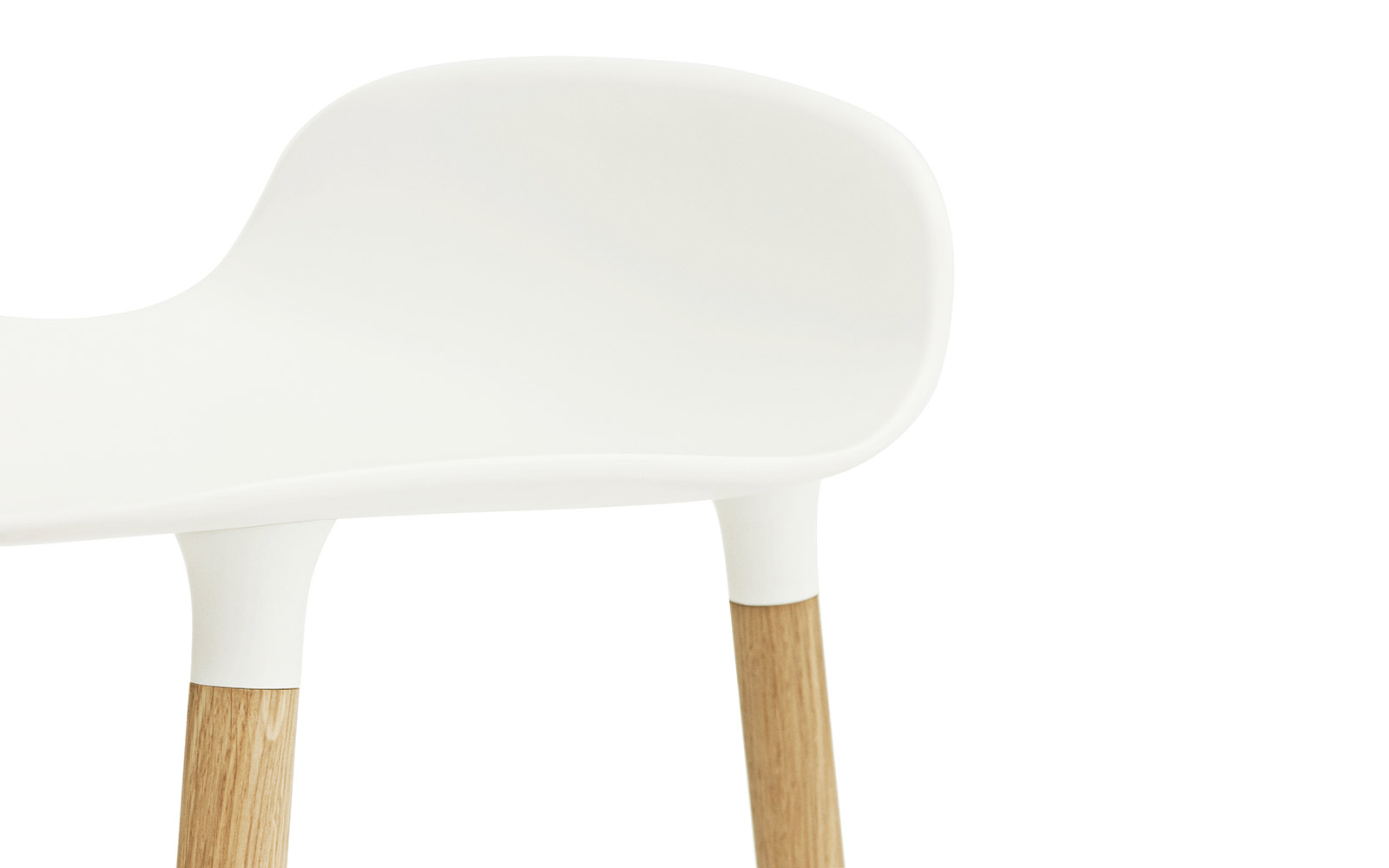 Form Chair | Molded plastic shell chair with oak legs