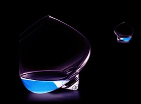 Cognac glass blue lagoon on black background