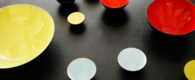 Krenit bowls on black table a design icon re-emerges after 50 years