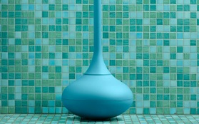 Ballo toilet brush front blue closeup green mosaic background