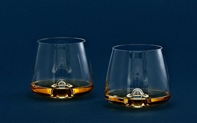 Whiskey glass two glasses action function drink on dark blue background